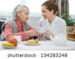 Senior Woman Eats Lunch At...