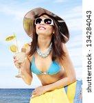Woman In Bikini Drinking...