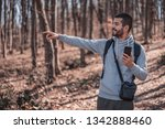 handsome young man in forest... | Shutterstock . vector #1342888460