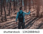 handsome young man in forest... | Shutterstock . vector #1342888463