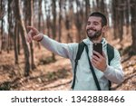handsome young man in forest... | Shutterstock . vector #1342888466