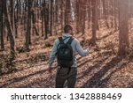 handsome young man in forest... | Shutterstock . vector #1342888469