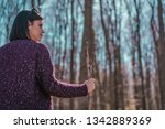 female hiking with wood stick... | Shutterstock . vector #1342889369