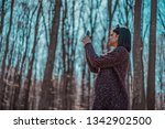 beautiful female in forest... | Shutterstock . vector #1342902500
