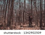 beautiful female in forest... | Shutterstock . vector #1342902509