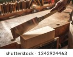 Small photo of Double edged Japanese pull saw on a wooden workbench