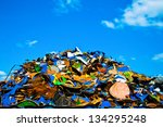 Colorful pile of metal waste on a recycling plant - stock photo