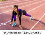 girl sportsman squats at sunset ...   Shutterstock . vector #1342972550