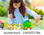 nice girl playing on easter...   Shutterstock . vector #1343021786