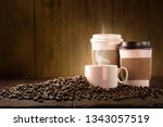coffee cup and coffee beans on... | Shutterstock . vector #1343057519