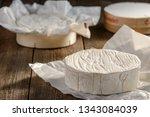 Unpacked Camembert Cheese Wheel