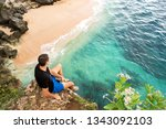 the guy is sitting on a rock...   Shutterstock . vector #1343092103