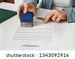 business woman putting stamp on ...   Shutterstock . vector #1343092916
