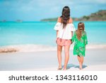 little girl and young mother at ... | Shutterstock . vector #1343116010