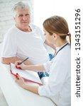 elderly man at the doctor  | Shutterstock . vector #1343151296
