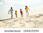 photo of happy family running... | Shutterstock . vector #134315294