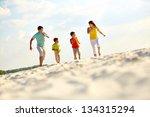 photo of happy family running... | Shutterstock . vector #134315294