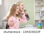 happy family mother and child... | Shutterstock . vector #1343230229