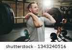 fit man in sportswear focused... | Shutterstock . vector #1343240516