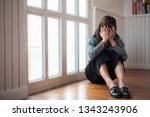 the woman sitting at the window ... | Shutterstock . vector #1343243906