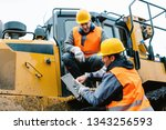 Small photo of Worker sitting on heavy excavation machinery in mining operation