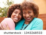 senior black mum and her middle ... | Shutterstock . vector #1343268533