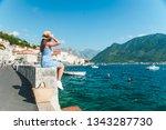 woman walking by perast city.... | Shutterstock . vector #1343287730