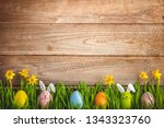 easter eggs and daffodil flower ... | Shutterstock . vector #1343323760