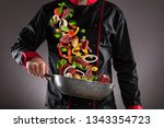 closeup of chef throwing beef... | Shutterstock . vector #1343354723