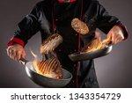 closeup of chef throwing beef... | Shutterstock . vector #1343354729