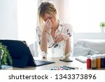 shot of exhausted young woman... | Shutterstock . vector #1343373896