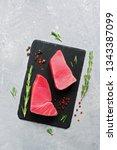 fresh raw tuna steak with... | Shutterstock . vector #1343387099