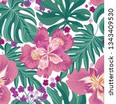 tropcal flowers and palm leaves ...   Shutterstock .eps vector #1343409530
