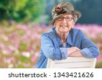 happy mature woman with casual... | Shutterstock . vector #1343421626