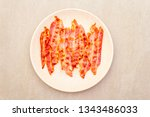 smoked fried bacon slices.... | Shutterstock . vector #1343486033