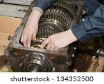 worker repairs transmission | Shutterstock . vector #134352500