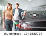 young couple buying first... | Shutterstock . vector #1343530739