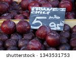 large dark red plums with price ... | Shutterstock . vector #1343531753