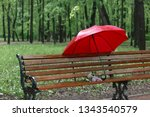 An Open Red Umbrella  Stands O...