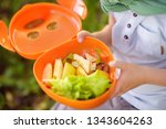 little boy is eating his lunch... | Shutterstock . vector #1343604263