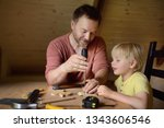 mature man and little boy make... | Shutterstock . vector #1343606546