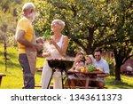 happy family having barbecue... | Shutterstock . vector #1343611373