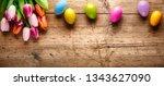 tulip flower and easter egg on...   Shutterstock . vector #1343627090