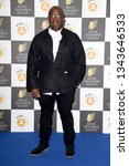 Small photo of LONDON, UK. March 19, 2019: Lucian Msamati arriving for the Royal Television Society Awards 2019 at the Grosvenor House Hotel, London. Picture: Steve Vas/Featureflash