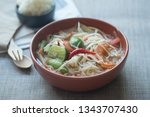 somtum or papaya salad with red ... | Shutterstock . vector #1343707430