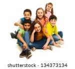 Small photo of Group of black and Caucasian kids sitting happy together, smiling and laughing