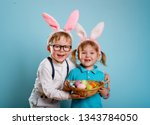 happy family playing on easter... | Shutterstock . vector #1343784050
