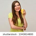 smiling woman holding orange... | Shutterstock . vector #1343814800