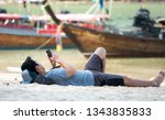 people chilling on the beach... | Shutterstock . vector #1343835833