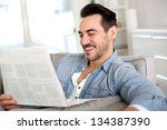 man relaxing at home with... | Shutterstock . vector #134387390